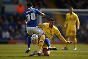 Ipswich Town defender Myles Kenlock (30)  gets tackled by MK Dons midfielder Daniel Powell (17)  during the Sky Bet Championship match between Ipswich Town and Milton Keynes Dons at Portman Road, Ipswich, England on 30 April 2016. Photo by Simon Davies.