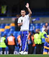 John Terry of Chelsea waves and greets fans after the Barclays Premier League match against Leicester City at Stamford Bridge, London<br />