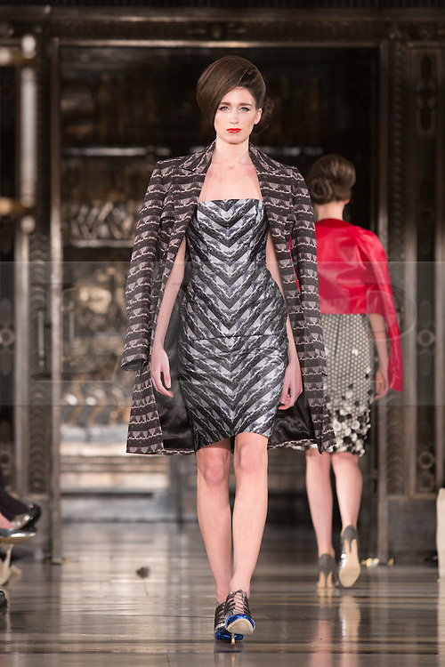 © Licensed to London News Pictures. 14 February 2014, London, England, UK. A model walks the runway at the Ong Oaj Pairam show during London Fashion Week AW14 at Fashion Scout/Freemasons' Hall. Photo credit: Bettina Strenske/LNP