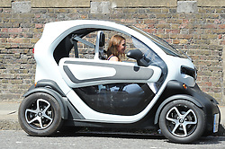 EXCLUSIVE: Geri Horner seen making the most of the sunshine as she opts for taking her electric car for a spin today. As Geri left her home this afternoon she was greeted by an eagerly awaiting fan outside hoping for the chance to get a selfie with the pop singer. Whilst waiting, the unknown fan tests the lighting on his phone ready for the big moment. Geri seemed more than happy to give the man what he wanted and a little more when she greeted him with a hand shake and a kiss. The unknown man walks off smiling with phone in hand having bagged more than he bargained for. 26 Jun 2017 Pictured: Geri Horner. Photo credit: IMP Features / MEGA TheMegaAgency.com +1 888 505 6342