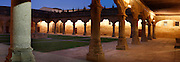 """Panoramic view of Cloister, Escuelas Menores (Minor Schools), 1428, University of Salamanca, Salamanca, Spain, pictured on December 18, 2010 in the evening, floodlit. Elegant arches surround a grassy quadrangle. Salamanca, an important Spanish University city, is known as La Ciudad Dorada (""""The golden city"""") because of the unique golden colour of its Renaissance sandstone buildings. Founded in 1218 its University is still one of the most important in Spain. Around it the Old Town is a UNESCO World Heritage Site. Picture by Manuel Cohen"""