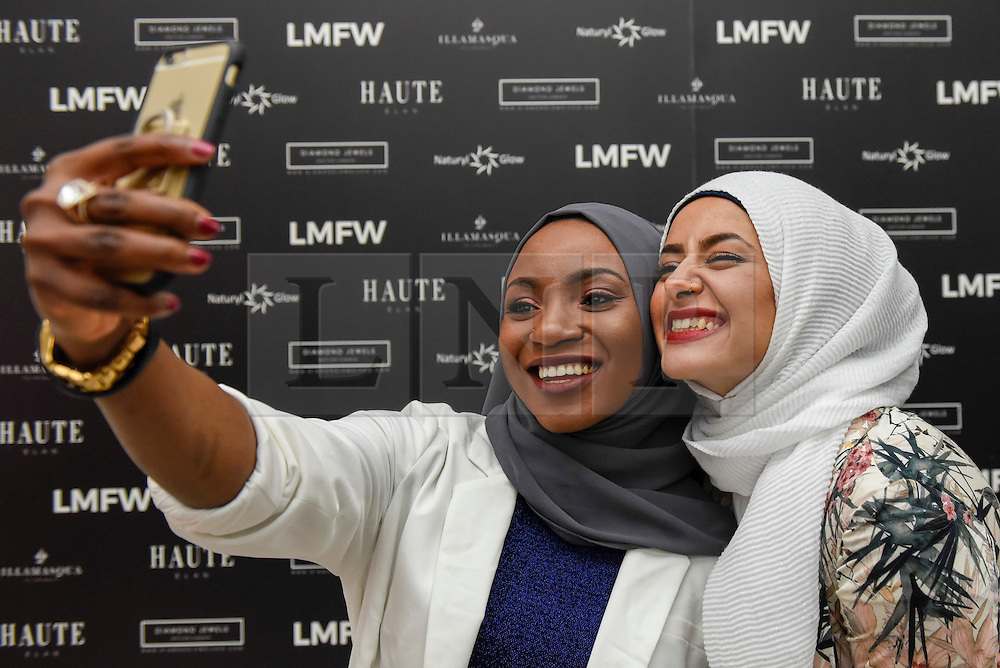 © Licensed to London News Pictures. 18/02/2017. London, UK.   Visitors take a selfie at the UK's first London Modest Fashion Week taking place this weekend at the Saatchi Gallery.  The two day event sees 40 brands from across the world come together to showcase their collections for Muslim and other religious women. Photo credit : Stephen Chung/LNP
