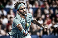PERTH, AUSTRALIA - JANUARY 02: Roger Federer of Switzerland plays a forehand to Dan Evans of Great Britain in the men's singles match on day two of the 2017 Hopman Cup at Perth Arena on January 2, 2017 in Perth, Australia.  (Photo by Paul Kane/Getty Images) *** Local Caption *** Roger Federer
