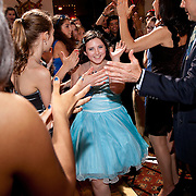 Bat Mitzvah runs through group of happy guests