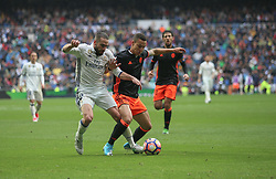 April 29, 2017 - Madrid, Spain - MADRID, SPAIN. APRIL 29th, 2017 - Dani Carvajal and Rodrigo. La Liga Santander matchday 35 game. Real Madrid defeated 2-1 Valencia with goals scored by Cristiano Ronaldo (26th minute) and Marcelo (86th minute). Parejo (82nd minute) scored for Valencia. Santiago Bernabeu Stadium. Photo by Antonio Pozo | PHOTO MEDIA EXPRESS (Credit Image: © Antonio Pozo/VW Pics via ZUMA Wire/ZUMAPRESS.com)