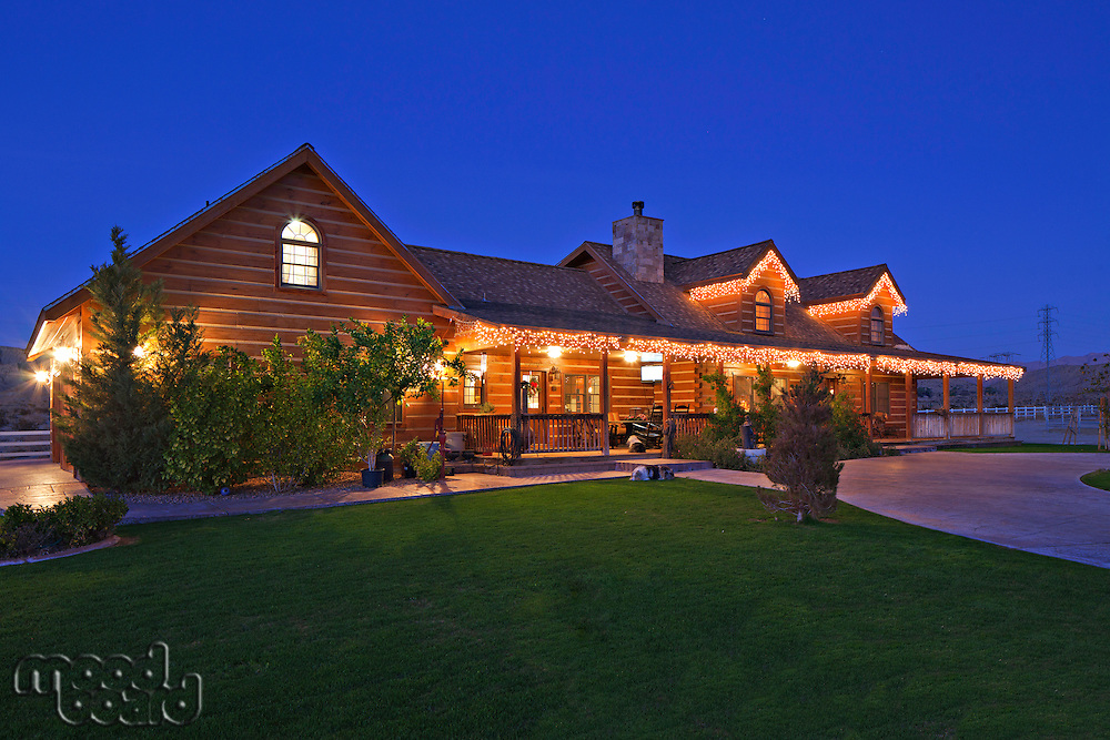 Angular view of ranch home at dusk