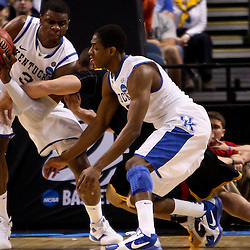 Mar 19, 2011; Tampa, FL, USA; \Kentucky Wildcats forward Terrence Jones (3) and guard Brandon Knight (12) battle for a loose ball with West Virginia Mountaineers forward Cam Thoroughman (2) during the second half of the third round of the 2011 NCAA men's basketball tournament at the St. Pete Times Forum. Kentucky defeated West Virginia 71-64.  Mandatory Credit: Derick E. Hingle