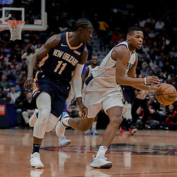Dec 29, 2017; New Orleans, LA, USA; Dallas Mavericks guard Dennis Smith Jr. (1) drives past New Orleans Pelicans guard Jrue Holiday (11) during the first quarter at the Smoothie King Center. Mandatory Credit: Derick E. Hingle-USA TODAY Sports
