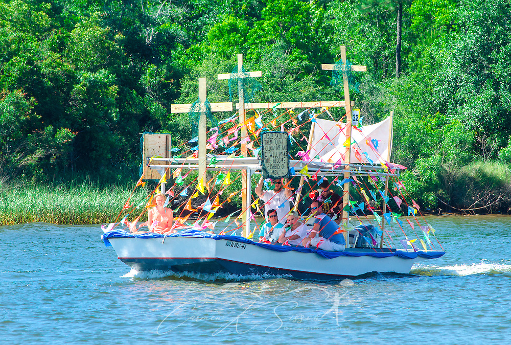 A decorated shrimp boat travels down the bayou during the 66th annual Blessing of the Fleet in Bayou La Batre, Alabama, May 3, 2015. The first fleet blessing was held by St. Margaret's Catholic Church in 1949, carrying on a long European tradition of asking God's favor for a bountiful seafood harvest and protection from the perils of the sea. The highlight of the event is a blessing of the boats by the local Catholic archbishop and the tossing of a ceremonial wreath in memory of those who have lost their lives at sea. The event also includes a land parade and a parade of decorated boats that slowly cruise through the bayou. (Photo by Carmen K. Sisson/Cloudybright)