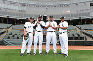 CHICAGO - APRIL 28:  Cuban born players (from left to right) Adrian Nieto #17, Alexei Ramirez #10, Jose Abreu #79 and Dayan Viciedo #24 of the Chicago White Sox pose for a portrait prior to the game against the Tampa Bay Rays on April 29, 2014 at U.S. Cellular Field in Chicago, Illinois.  (Photo by Ron Vesely)   Subject: Adrian Nieto; Alexei Ramirez; Jose Abreu; Dayan Viciedo