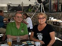 """Cousin"" Bob and Judy Somerville enjoy lunch outside under the tent at the 405 Pub and Grill on Wednesday.  (Karen Bobotas/for the Laconia Daily Sun)"