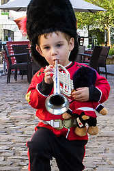 In his full regalia complete with trumpet Two year-old Alex Tonkin from Windsor loves to watch the soldiers march every day through his home town as excitement builds up in Windsor ahead of the royal wedding on Saturday 19th May when HRH Prince Harry weds actress Megan Markle. Windsor, May 17 2018.