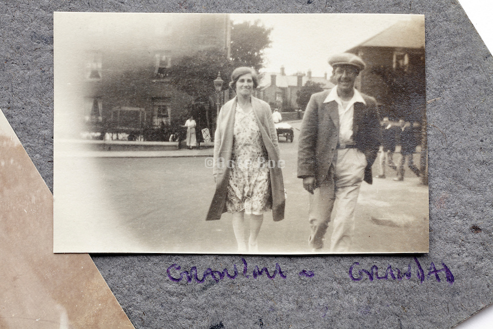 adult couple on a walking outing in photo album page early 1900s England