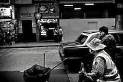 Hong Kong | HongKong | 01.12.2012 :  Kowloon<br /> <br /> hier: Stra&szlig;enkehrerin<br />   <br /> Sascha Rheker<br /> 20121201<br /> <br /> <br /> <br /> [Inhaltsveraendernde Manipulation des Fotos nur nach ausdruecklicher Genehmigung des Fotografen. Vereinbarungen ueber Abtretung von Persoenlichkeitsrechten/Model Release der abgebildeten Person/Personen liegt/liegen nicht vor.] [No Model Release | No Property Release]