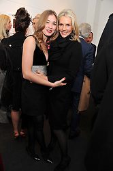 Left to right, ANOUSKA BECKWITH and CHARLENE de GANAY at a private view of photographs by Anthony Souza held at The Little Black Gallery, 13A Park Walk, London SW10 on 13th December 2011.