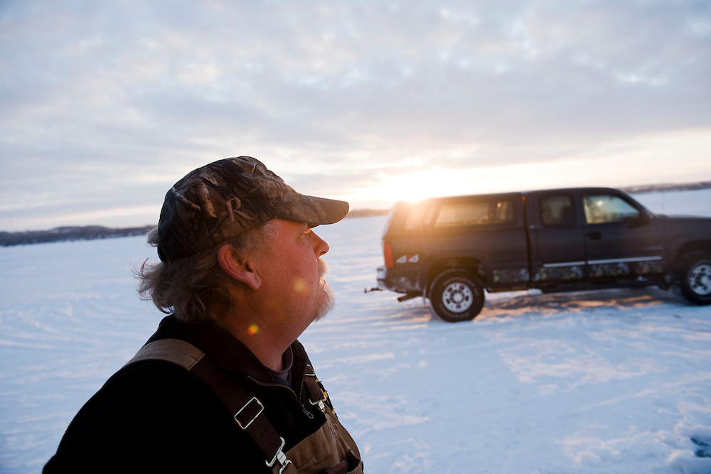 STOCKBRIDGE, WI -FEB. 17, 2015: Tom Krueger, 51, looks out over the ice shortly after arriving at his shanty for the start of the spear fishing day, Tuesday, Feb. 17, 2015. 13,000 licenses were sold for the 2015 sturgeon spearing season which started Feb. 14, 2015 and lasted until Feb. 21, 2015 on Lake Winnebago with a total of 1870 sturgeon speared. The average success rate for spearers is 10-12% and some people go years without spotting anything from their shanty. Lauren Justice for The New York Times