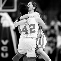 Kyle Green | The Roanoke Times<br /> March 10, 2011 J.I. Burton High School girls basketball players Jessica Hensley (facing camera) and Cherish Forney (#42) celebrate at mid court after their win against Sussex Central High School during the Group A Division 1 Girls final game at the 2011 VHSL basketball championships held at the Siegel Center in Richmond, Virginia. J.I. Burton defeated Sussex Central 65-52.