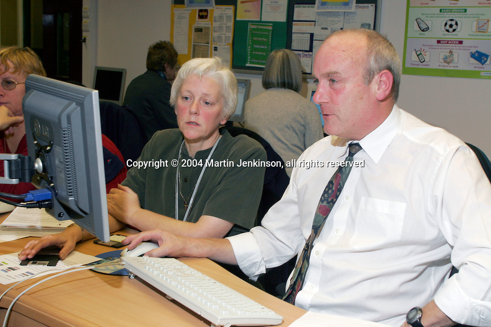 Terry Phillips, Tibshelf Community School, and tutor Judi Machin NUT ICT course at Chesterfield College...© Martin Jenkinson, tel 0114 258 6808 mobile 07831 189363 email martin@pressphotos.co.uk. Copyright Designs & Patents Act 1988, moral rights asserted credit required. No part of this photo to be stored, reproduced, manipulated or transmitted to third parties by any means without prior written permission