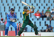 PRETORIA, South Africa, 11 December 2013. AB de Villiers of South Africa batting with Mahendra Singh Doni of India at the wicket during the 3rd ODI Cricket match between South Africa and India at Super Sport Park in Centurion Pretoria, South Africa on Wednesday 11 December 2013.<br /> Photographer : Anton de Villiers / SASPA