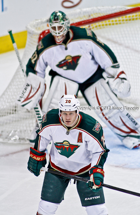 SHOT 3/16/13 3:18:25 PM - The Minnesota Wild's Ryan Suter #20 and Niklas Backstrom #32 prepare for a face off in their own zone while playing against the Colorado Avalanche during their regular season NHL game at the Pepsi Center in Denver, Co. The Minnesota Wild won the game 6-4. (Photo by Marc Piscotty / © 2013)