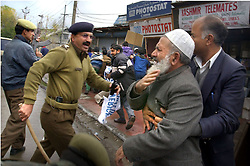 Jammu and Kashmir police charge and arrest Moulana Mohammed Tahri who is the second in charge of the Democratic Freedom Party as others run away after they attempted to  march in the streets of Srinagar, Kashmir Tuesday, November 6. The war in Kashmir has been going on since 1989 when militant organizations chose to fight for secession from India.