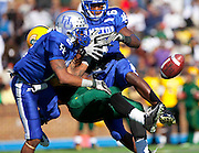 Hampton's James Butts (2) and Ricardo Silva (6) break up this pass during their 7 - 6 victory over Norfolk State held at Armstrong Stadium on the campus of Hampton University in Hampton, Virginia.  (Photo by Mark W. Sutton)