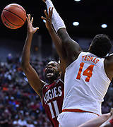 SAN DIEGO, CA - MARCH 16:  Johnathon Wilkins #11 of the New Mexico State Aggies is fouled by Elijah Thomas #14 of the Clemson Tigers during a first round game of the Men's NCAA Basketball Tournament at Viejas Arena in San Diego, California. Clemson won 79-68.  (Photo by Sam Wasson)