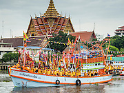 "23 JUNE 2015 - MAHACHAI, SAMUT SAKHON, THAILAND:  Attendants of the City Pillar Shrine on a fishing boat goes up the Tha Chin (Chin River) during the City Pillar Shrine procession in Mahachai. The Chaopho Lak Mueang Procession (City Pillar Shrine Procession) is a religious festival that takes place in June in front of city hall in Mahachai. The ""Chaopho Lak Mueang"" is  placed on a fishing boat and taken across the Tha Chin River from Talat Maha Chai to Tha Chalom in the area of Wat Suwannaram and then paraded through the community before returning to the temple in Mahachai.   PHOTO BY JACK KURTZ"