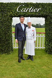 Left to right, LAURENT FENIOU MD of Cartier UK and ANTON MOSIMANN at the Cartier Queen's Cup Final 2016 held at Guards Polo Club, Smiths Lawn, Windsor Great Park, Egham, Surry on 11th June 2016.