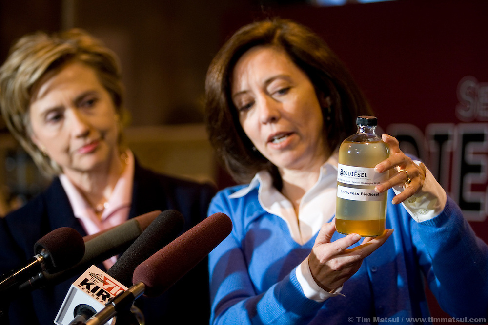 """SEATTLE, WA - Friday, January 27, 2006 U.S. Senator Maria Cantwell (D-WA) holds a jar of partially refined biodiesel while U.S. Senator Hillary Clinton (D-NY) looks on. The two senators were at Seattle Biodiesel to promote energy independence and call for a greater federal support for ground-brakening alternative energy initiatives already underway at the local level. Cantwell is signing on to Clinton's legislation to create a latter-day """"Manhattan Project"""" aimed at accelerating the development of advanced energy technologies.  The two senators, with democratic leader Harry Reid (D-NV) are sponsoring the Advanced Research Projects Energy (ARPA-E) Act to fund alternative energy research. Cantwell states that reliance on foreign oil is a threat to the U.S. economy, competitiveness, and national security and she supports development of non-petroleum based fuels and energy sources. Seattle Biodiesel is working with Cantwell and Washington Governor Gregoire to help develop a market for biodiesel and recently signed a fuel contract with the Port of Seattle. Negotiations are currently underway for Seattle Biodiesel to expand its operations to create the nation's largest biodiesel refinery and to do so on Port property. Clinton is also in the Pacific Northwest to support her fellow democrats at fundraisers and to solidify her support. (Photo by Tim Matsui/WpN)"""
