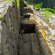 This is typical Aqueduct of Machu Picchu.