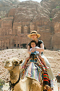 Middle East, Jordan, Petra, UNESCO World Heritage Site. European tourists on a camel