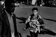 """Man and child in Chinatown...Part of long-term (2005-2008) story """"I See A Darkness"""". New York, NY."""