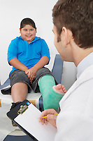 Doctor interviewing boy-patient