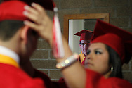 "Senior Luis ""Yayo"" Torres checks himself in the mirror June 1, 2012 as students get ready for their graduation ceremony in Premont."