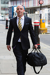 © Licensed to London News Pictures. 24/07/2014. London, UK. Former News of the World reporter, Dan Evans leaves the Old Bailey in London on 24th July 2014 after receiving a 10 month suspended jail sentence in connection with the phone hacking trial. Photo credit : Vickie Flores/LNP