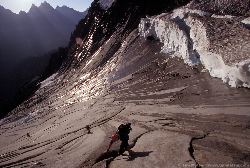 On the slabs below the pocket glacier on the NE Buttress of Mt. Slesse..