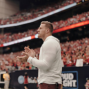 Houston Texan, JJ Watt, watches the game from the sidelines.<br /> <br /> Todd Spoth for The New York Times.