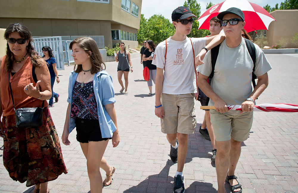 mkb070517c/metro/Marla Brose --  Harrison Cassar of Palm Desert, CA, second from left, leans on his dad Rick Cassar during a campus tour, Wednesday, July 5, 2017, at the University of New Mexico, in Albuquerque, N.M.  Next to them is Morgan Rucker of South Carolina, second from left, and Teresa Prater, left, her grandmother.  (Marla Brose/Albuquerque Journal)