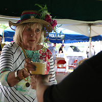Janice Coleman gets a Mint Julep Saturday at the 20th annual Kentucky  Derby Party