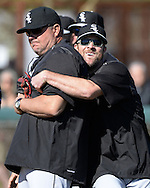 GLENDALE, AZ - FEBRUARY 25:  John Danks #50 playfully hugs coach Mark Parent of Chicago White Sox looks on during spring training workouts on February 25, 2015 at The Ballpark at Camelback Ranch in Glendale, Arizona. (Photo by Ron Vesely)   Subject:   John Danks; Mark Parent