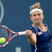 August 16, 2014, New Haven, CT:<br /> Timea Bacsinszky hits a forehand during a match against Caroline Wozniacki on day four of the 2014 Connecticut Open at the Yale University Tennis Center in New Haven, Connecticut Monday, August 18, 2014.<br /> (Photo by Billie Weiss/Connecticut Open)
