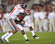 Ole Miss cornerback Marcus Temple (4) tackles Alabama wide receiver Darius Hanks (15) at Bryant-Denny Stadium in Tuscaloosa, Ala.  on Saturday, October 16, 2010. Alabama won 23-10.