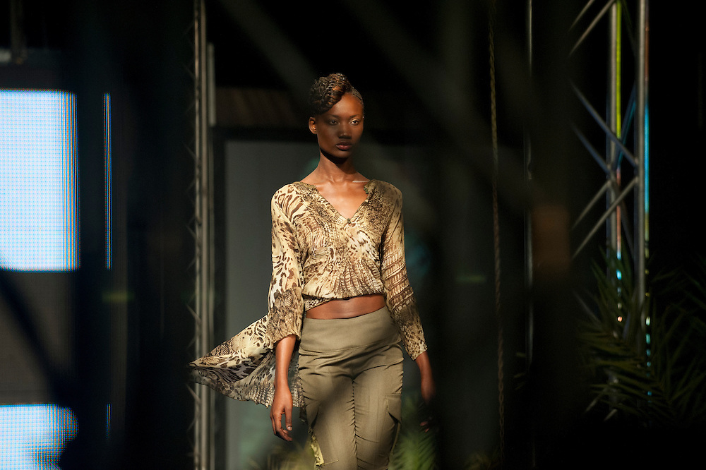 15/06/2012. Senegal, Dakar.   A model presents a creation by Moroccan designer Karim Tassi, on June 15, 2012 at the third day of the Dakar Fashion Week's 10 year anniversary taking place from June 12 to 17. ©Sylvain Cherkaoui