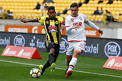 The Phoenix's Roy Krishna, left and Adelaide United's Benjamin Garuccio contest the ball in the A-League football match at Westpac Stadium, Wellington, New Zealand, Sunday, October 08, 2017. Credit:SNPA / Dean Pemberton **NO ARCHIVING**