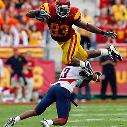 USC tight end Fred Davis (83) leaps over Arizona's Wilrey Fontenot (3) for a first down in the third quarter at the Los Angeles Coliseum Saturday, October 13. 2007, in Los Angeles,Calif.<br /> (Pasadena Star-News Keith Birmingham)