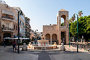 Israel, Jaffa, Jerusalem Boulevard, arched passage and fountain in front of the Noga Theatre.. The arches were added to the building in 1996 to give it an Oriental style