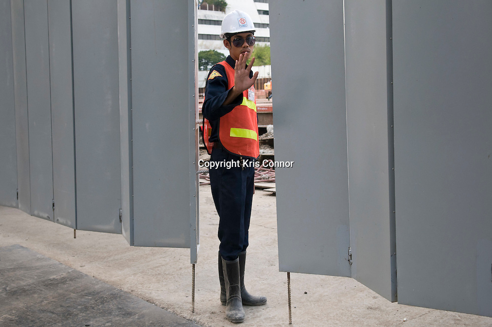 A construction worker in the Pathum Wan District in Bangkok, Thailand. Photo by Kris Connor