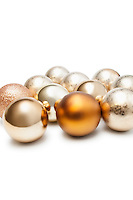 Group of Christmas baubles over white background
