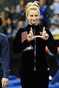 University of Utah freshman Mary Beth Lofgren flashes the Ute sign to fans from the podium after tying for fifth place with Melissa Fernandez of the University of Illinois (not shown) at the 2011 Women's NCAA Gymnastics Championship Individual Event Finals on April 17, in Cleveland, OH. (photo/Jason Miller)